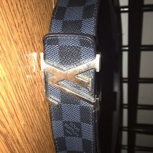 Louis Vuitton's. grey and black bearly worn